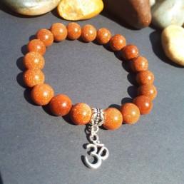 Om & Gold Goldstone Bracelet